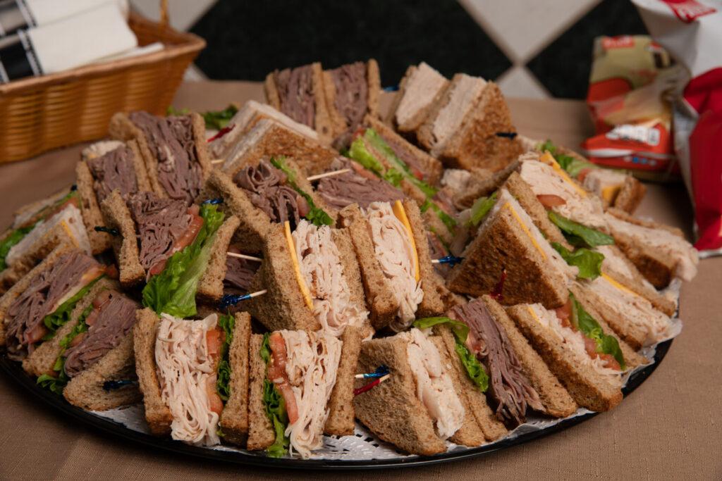 deniros catering spread of club sandwiches