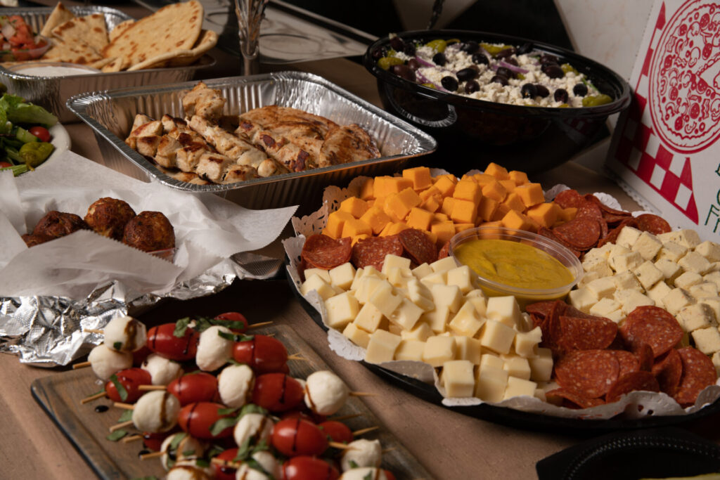 deniros catering spread of meats and cheese